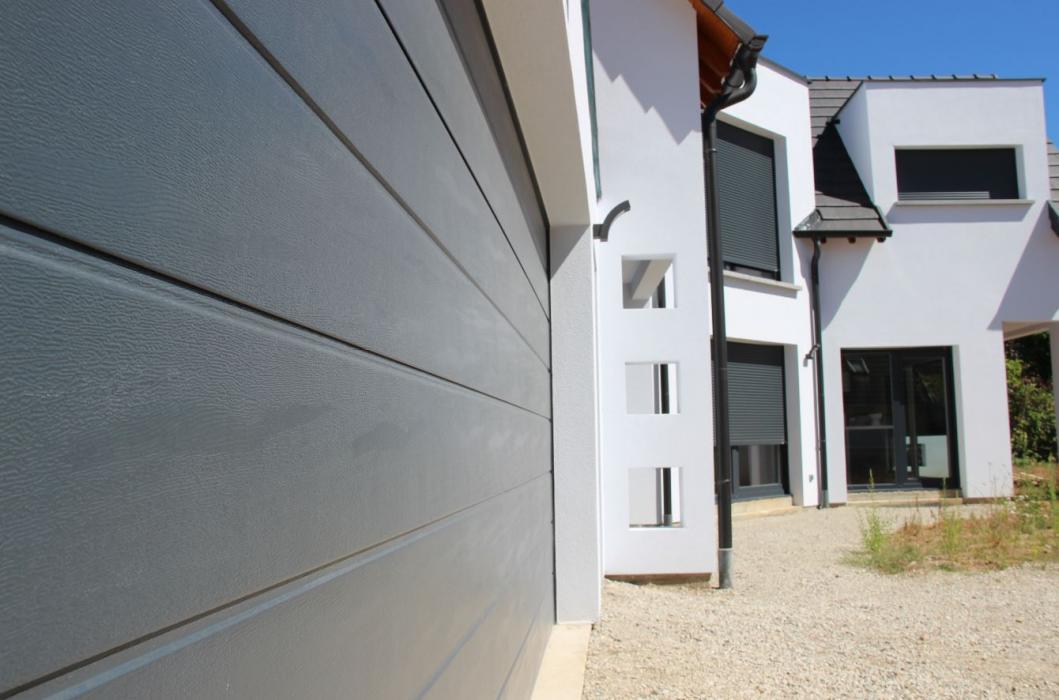 Zoom sur signature Maisons Home Conception